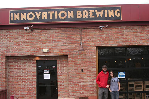 Owners, Chip and Nicole, in front of Innovation Brewing Sylva NC